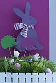 Easter arrangement of grass, tulips, hedgehog and Easter bunny