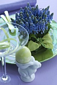 Grape hyacinths and Easter egg in egg cup
