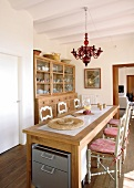 Mediterranean dining room with turned wooden chairs and wooden table with modern inlaid panel