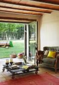 Coffee table on castors in front of open terrace doors in Mediterranean living room