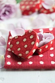 Gift box with rose petals