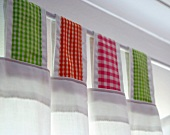 Curtain with loops of checked fabric on curtain rod