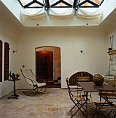 Mediterranean-style rooftop vestibule with awnings below skylight