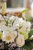 White bouquet of gerbera daisies, roses, carnations and lilies
