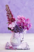Pink hydrangeas and summer lilacs in a porcelain vase