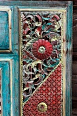 Painted and carved wooden panel