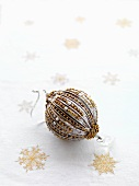 Christmas bauble decorated in silver and gold
