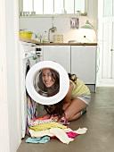 Woman filling washing machine