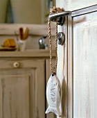 Fish pendant hanging on bathroom door handle