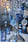 Christmas decorations hanging on silver candlestick