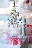 Present prettily wrapped with ballet shoe baubles beneath vintage miniature chandelier