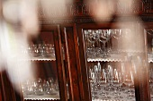 Wine glasses in antique display cabinet