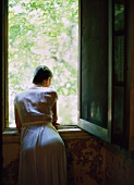 A young woman looking out of the window