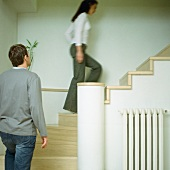 A young man and a young woman going upstairs