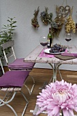 Garden table with red wine