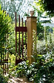 Simple iron gate leading from garden