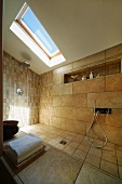 Designer bathroom in attic - tiled shower area with wall and floor tiles of different sizes