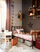 Vintage bed in corner of child's bedroom with toys in shelving modules on brown wall