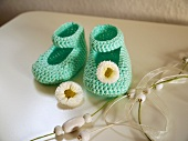 Crocheted baby bootees