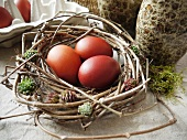 Brown eggs in Easter nest