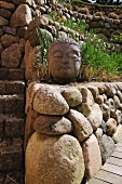 Buddha statue made of stone in garden