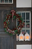Front door with Christmas wreath and windlights