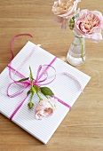 Wrapped gift with rose blossoms