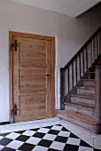 Wooden door and staircase