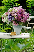 Colorful bunch of flowers on garden table