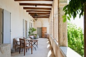 Antique chair and table on arcade veranda of Mediterranean country house