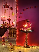 Pink and gold Christmas decorations with candles and fairy lights