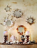 Mirrors with original frames and Christmas decorations on small console table