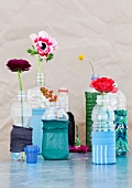 Plastic bottles decorated with remnants of stockings and used as vases