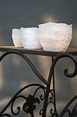 Hand-made paper tealight holders on side table with vintage metal frame