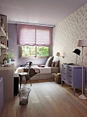 Lilac teenager's room - Neo-baroque chest of drawers painted purple against wall with patterned wallpaper and bed below window with half-closed blind
