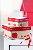 Red tape and tape with apple motif on small gift boxes