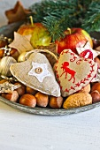 Dish of nuts and Christmas decorations