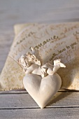 Angel and heart decoration on scented sachet