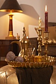 Arabian tea service and gilt candlesticks on tray in living room