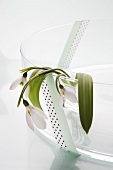 Snowdrops in a glass bowl decorated with masking tape
