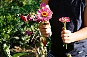 Little boy holding garden flowers