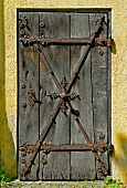 Antique wooden door with wrought iron fittings