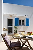 Breakfast table on terrace of white Finca