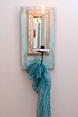 Candle sconce with mirror and draped scarf