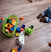 Babys toys on wooden floor