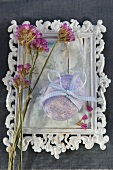 Easter egg with ribbon bow on white-painted vintage picture frame