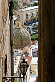 View of church dome with multi-coloured tiles in Positano