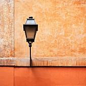 Street lamp on a building facade (Italy)