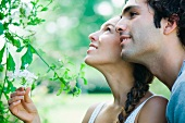 Couple looking at flowering plant together
