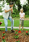 A father and daughter gardening